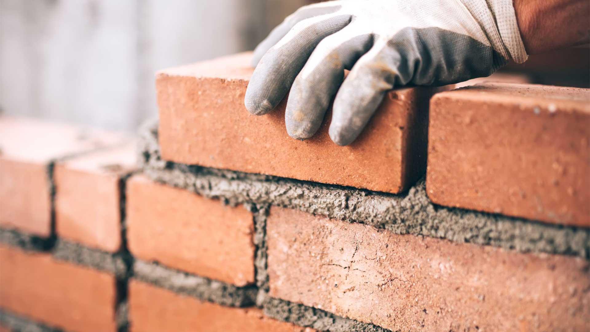 bricklayer-installing-brick-wall.jpg